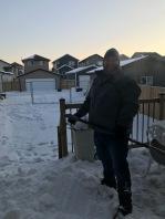 Adrian shoveling
